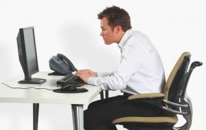 ergonomically correct sitting to prevent injury or pain